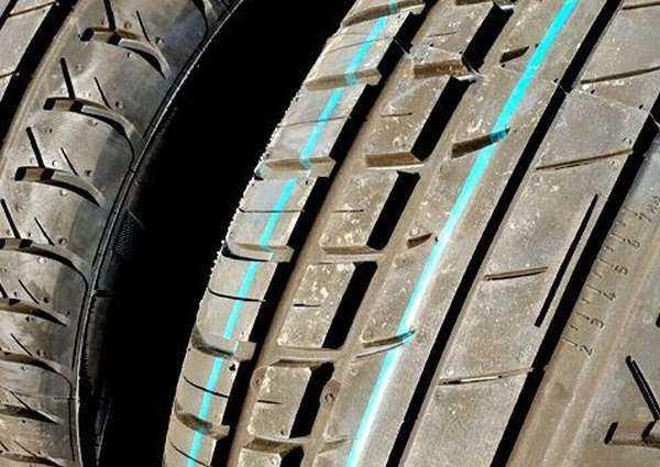 Зачем на шинах ставят разноцветные точки
